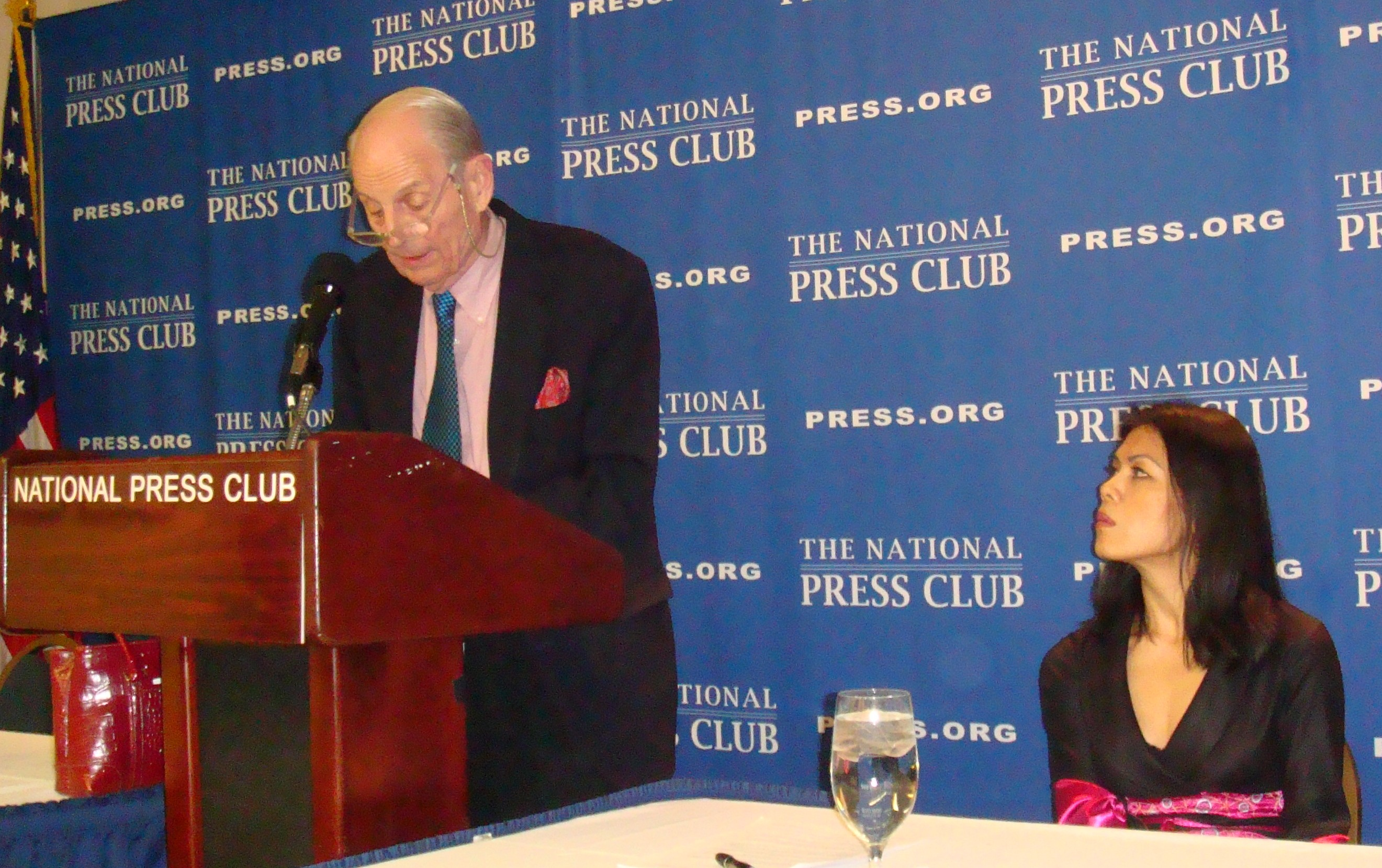 Peter Hickman introducing Theary Seng at the Newsmaker program of the National Press Club, March 2010